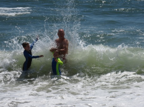 Getting pounded in the surf.