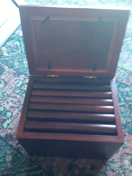"This is embarrassing. It's a box that holds tiny photo albums. I've had it for years. I was mocked when I got it (I was told that it was ""cheesy"" and I never even loaded all the pictures up. I'm going to scan the photos and DONATE."