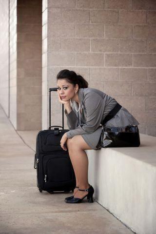 bigstockphoto_bored_hispanic_woman_traveler_5159129.s600x600