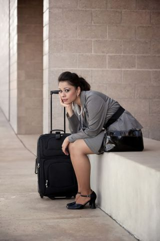 bigstockphoto_bored_hispanic_woman_traveler_5159129.s600x600